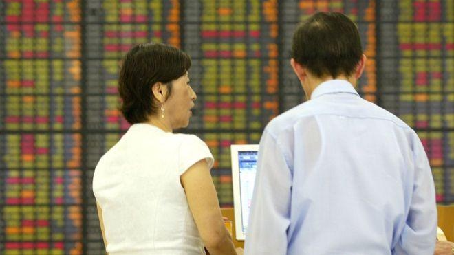 Global stocks hit record high as Biden, vaccine lift global prospects